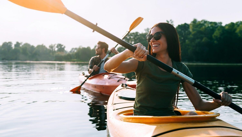 couple kayaking on lake