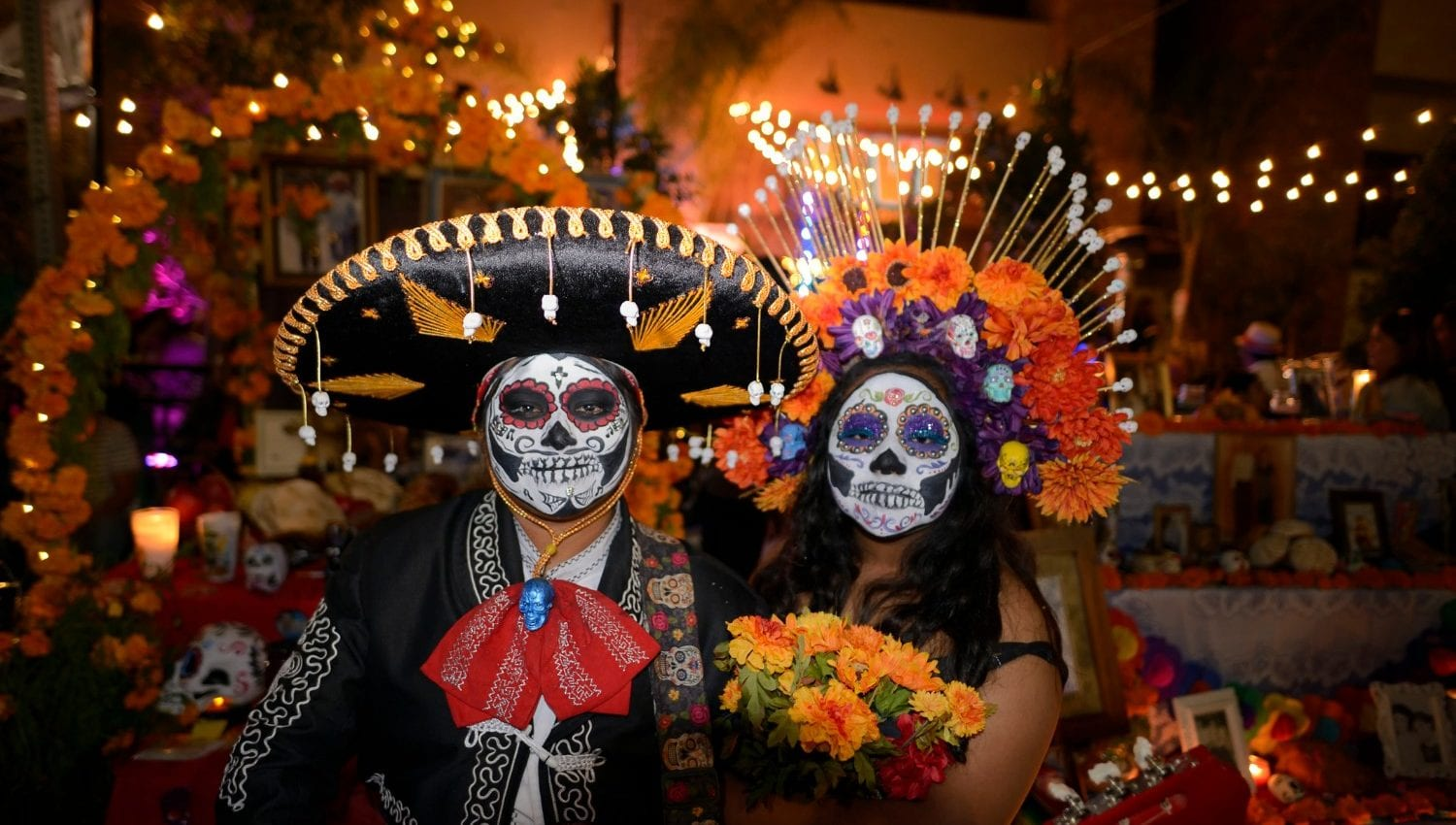 Couple in festival attire during el dia de los muertos