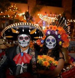 Couple in festival attire during el dia de los muertos