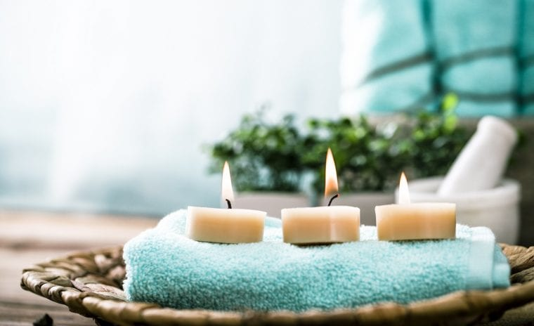 3 candles on spa towel