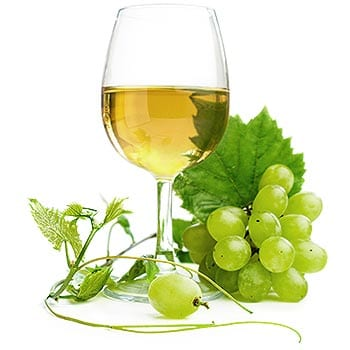 Wine glass and bunch of grapes
