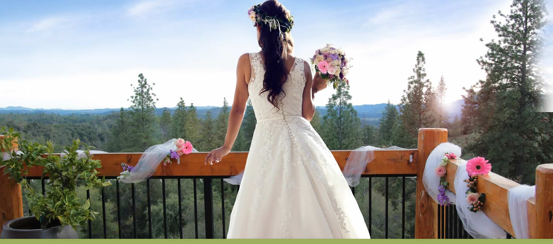 Bride at Courtwood Inn deck enjoying scenic forest view