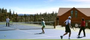 People playing tennis on the court at Courtwood Inn