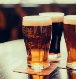 Three glasses of beer in pint glasses