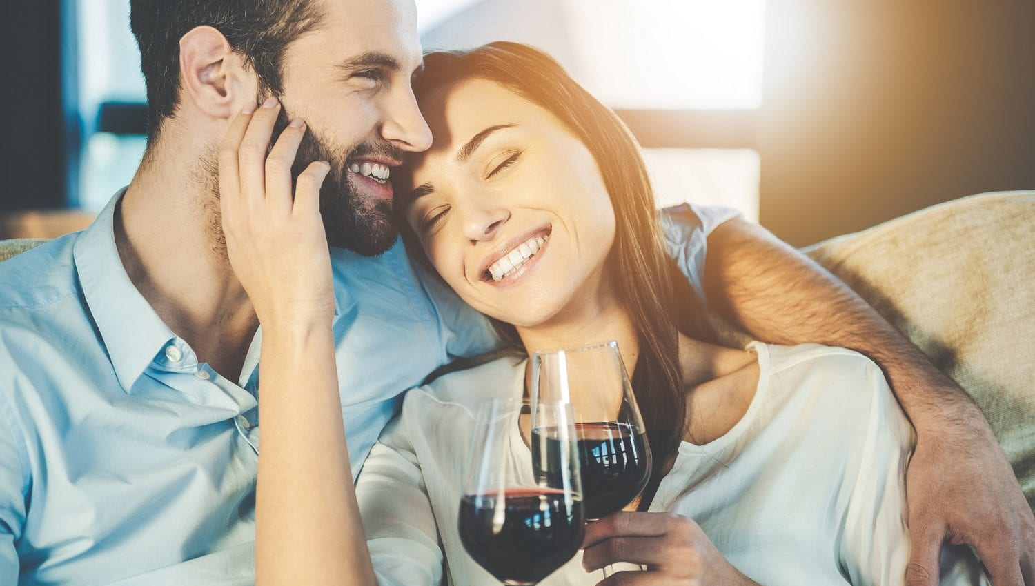 Couple with glasses of red wine