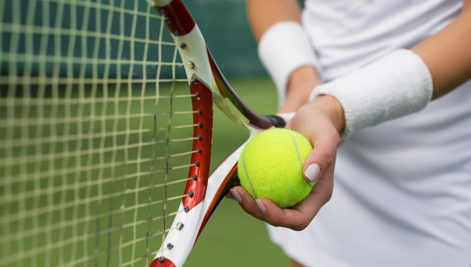 Person with a tennis ball and racket