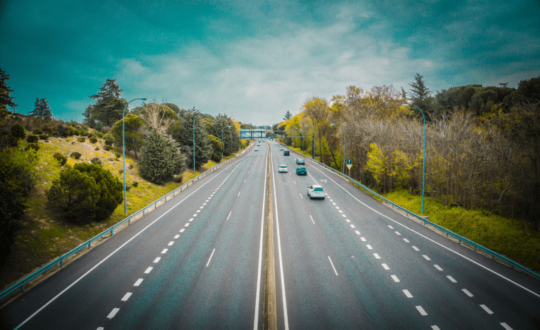 cars driving on scenic highway