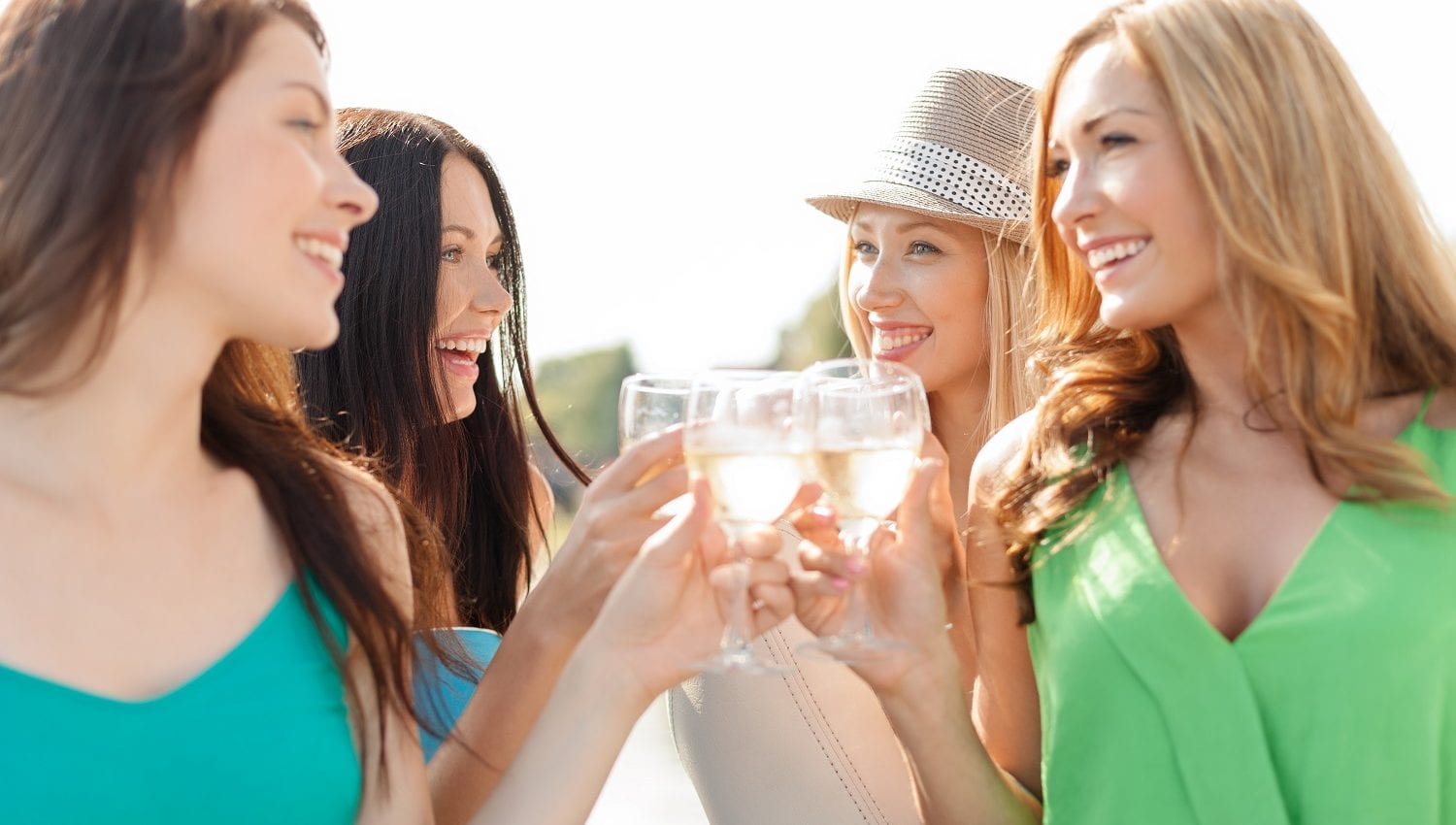 smiling girls with champagne glasses